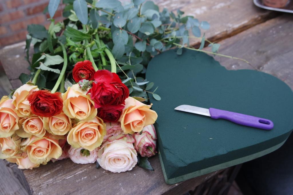Röda rosor i växthus